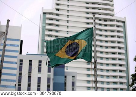 Salvador, Bahia / Brazil  - November 10, 2017: Torn Brazil Flag Is Seen On A Commercial Building Mas