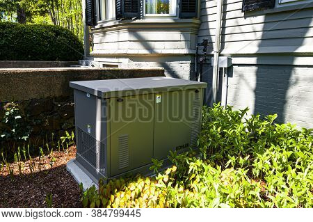 Newbury, Usa - May 10, 2017: Residential Standby Generator At The House Wall