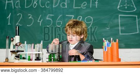 Little Boy At Lesson. Back To School. Biology School Laboratory Equipment. School Kid Scientist Stud