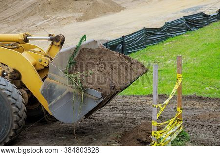 Earth Moving Equipment At New Development Bulldozer Earthmoving Dozer Is Moving Soil Is Leveling The