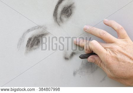 One Hand Drawing A Womans Face With Pastel Chalk