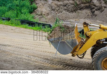 Construction Bulldozer Leveling And Moving Soil Landscaping Works On The Earthmoving