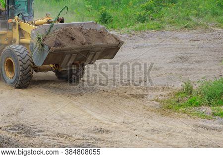 Earth-moving Equipment, Bulldozer Digging Ground During Of Moving Earth A Soil