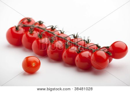 Bunch Of Ripe Red Cherry Tomatoes Close-up On White Background