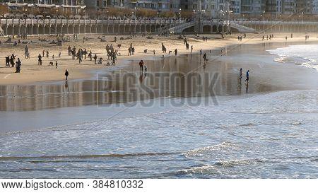 San Sebastian, Spain - December 30, 2017: People In The Beach In San Sebastian.