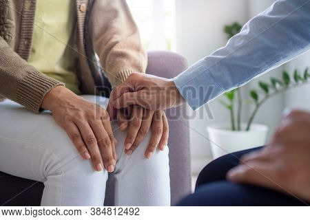 The Hands Of A Psychiatrist Hold The Patient's Hand To Encourage And Encourage Recovery From Depress