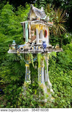 Old Spirit House Left Neglected In Bushes.
