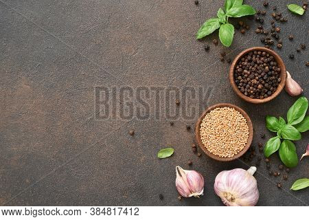 Salt, Peppercorns, Fresh Basil On A Concrete Background. View From Above.