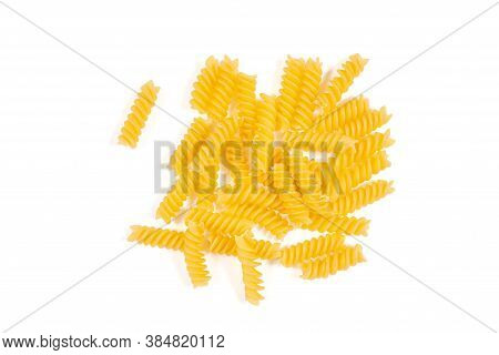 Uncooked Fusilli Pasta Isolated On White Background. Top View. Heap Of Dry Fusilli Pasta