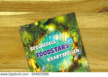 Zaandam, The Netherlands - September 9, 2020: Dutch Game Rules Flyer For Foodstars Card Action By Gr
