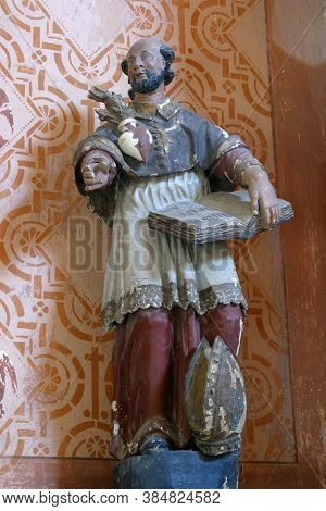 STARI FARKASIC, CROATIA - OCTOBER 10, 2013: St. Charles Borromeo statue on the altar of St. Anthony the Hermit at the Church of the Visitation of the Virgin Mary in Stari Farkasic, Croatia