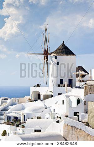 Traditional Windmills In Village Oia Of Cyclades Island Santorini Greece
