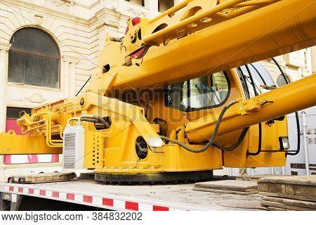 Yellow Crane On Construction Site, Crane Cab Closeup.