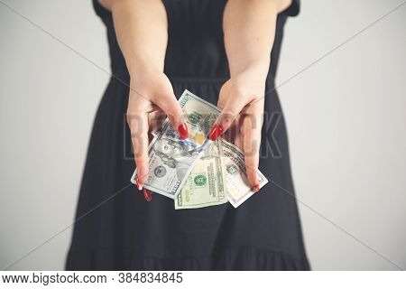 Young Fashion Business Woman Hand Money On Grey Background.