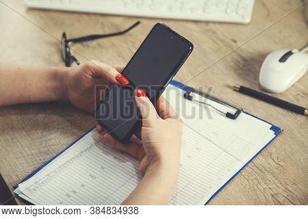 Hand Holding Using Mobile Phone.girl Using Smart Phone