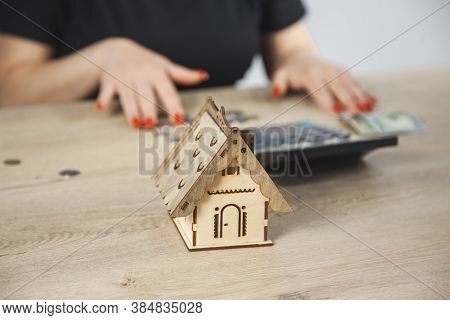 Woman Hand House Model With Documents On Desk.