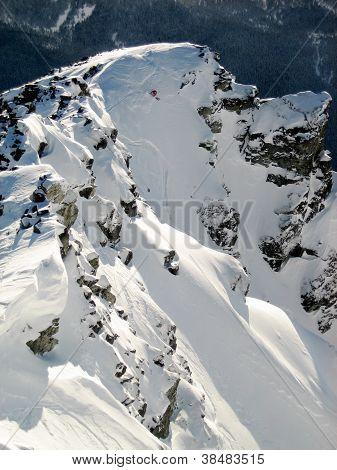 Steep chute skiing off Disease Ridge in Whistler, BC backcountry