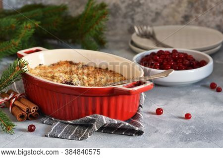 Crumble With Berries And Nuts On A Concrete Background.