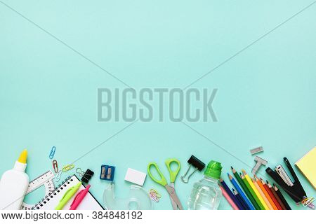 Back To School. School Accessories On Paper Mint Background. Layout.
