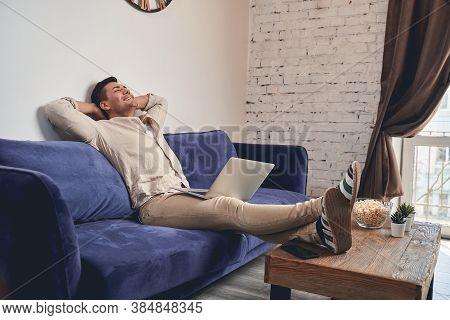 Blissful Man Taking A Break From Work