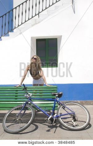 Sexy Woman With A Bike Relaxing