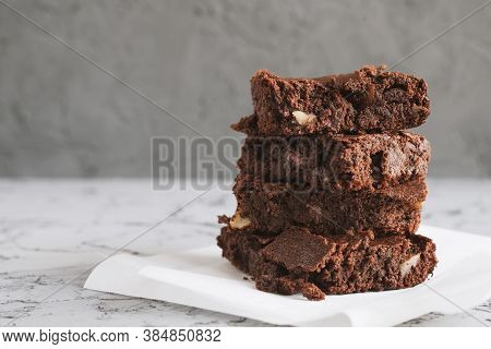 Homemade Brownies With Nuts Served On A Piece Of White Paper. Fudgy Chocolate Dessert