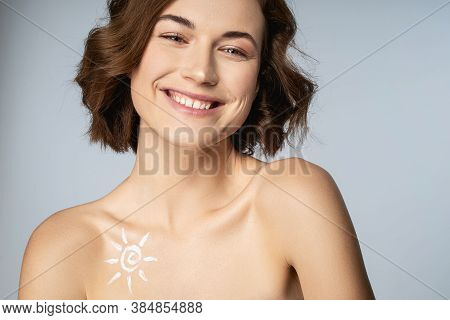 Positive Delighted Young Woman Posing On Camera