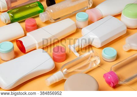 Group Of Plastic Bodycare Bottle Flat Lay Composition With Cosmetic Products On Colored Background E