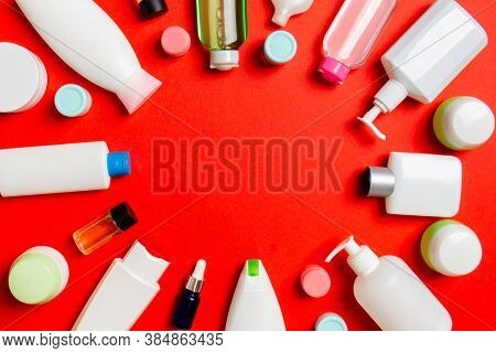 Frame Of Plastic Bodycare Bottle Flat Lay Composition With Cosmetic Products On Colored Background E