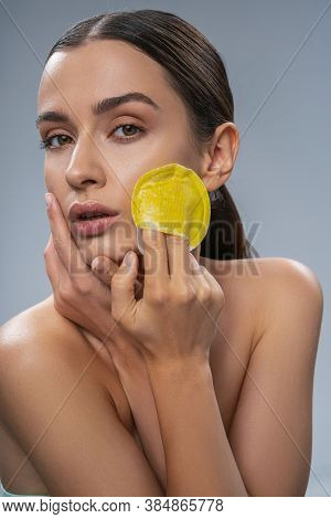 Beautiful Female Doing Face Cleansing With Washcloth