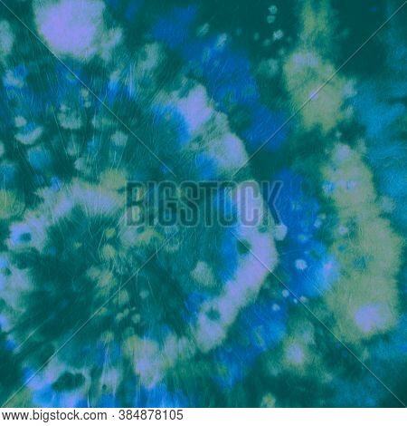 Tie Dye Spiral. Green Color Fabric. Tie-dye Circle Pattern. Hippie Psychedelic Painting. Batik Light