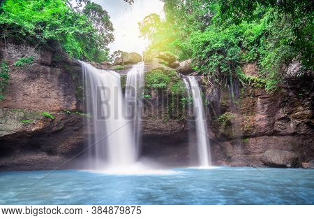 Travel To The Beautiful Waterfall In Deep Forest, Soft Water Of The Stream In The Natural Park At Ha