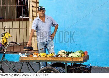 Camaguey, Cuba - December 19, 2016: Street Vendor Selling Fruit And Vegetables On His Bike In The St