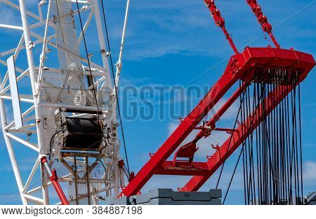 Closeup Crawler Crane With Wire Rope Sling On Crane Reel Against Blue Sky. Lifter Equipment In Const