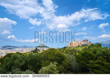 Iconic View Of Acropolis Hill And Lycabettus Hill In Background In Athens, Greece From Pnyx Hill In