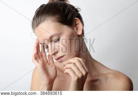 portrait of a beautiful girl with headache