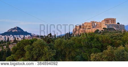 View Of Acropolis Hill And Lycabettus Hill In Background In Athens, Greece From Pnyx Hill In Soft Su