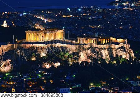 Close View Of Acropolis, Parthenon And Erechtheion, Philoppapos Monument At Night. City Lights Of At