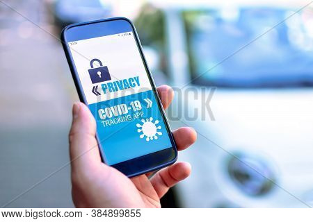 Privacy Concerns With Corona Virus Tracking App Concept Showing Hand Holding Cell Phone With Applica