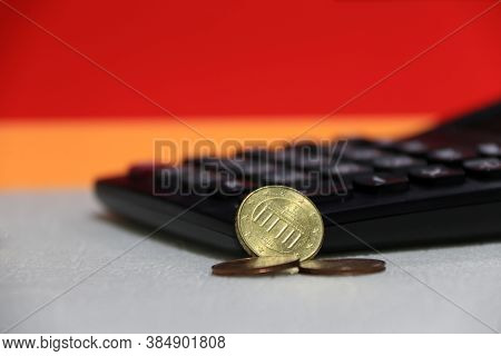 Ten Germany Euro Cent On Obverse And Two Coin Of Two Euro Cent On White Floor With Black Calculator,