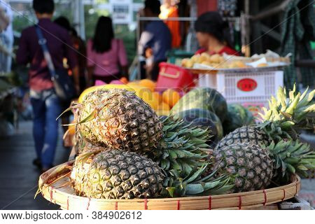Pineapple Placed In The Threshing Basket For Sale In The Street Fruit Shop.