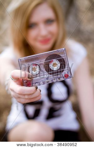 The Girl With A Cassette In Her Hand