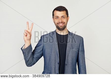 Young Businessman Man With Beard Smiling, Showing Number Two With Fingers On Hand, Smiling Confident