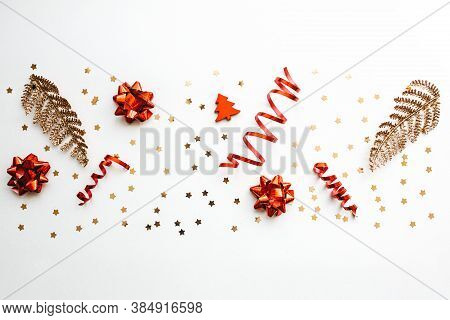 Gold And Red Christmas Items On A White Background. Christmas Or New Year Conceptual Background.