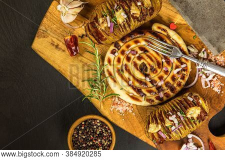 Delicious White Sausage Grilled With Potatoes. Set Of Grilled Sausages A Wooden Board Hunting Sausag