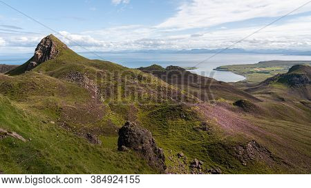 Scenic View Of The Quiraing And Sea, Isle Of Skye, Scotland. Beautiful Area Of Grassy Mountains Cove