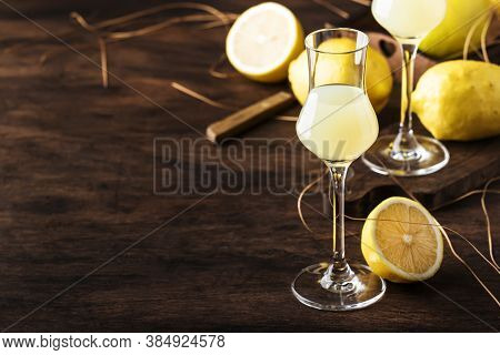 Limoncello, Sweet Italian Lemon Liqueur, Traditional Strong Alcoholic Drink. Still Life In Vintage S