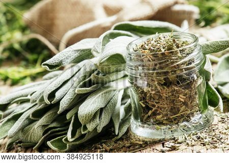 Dried Sage In A Glass Jar, Fresh Sage On The Vintage Wooden Table, Preparation Of Medicinal Herbs Dr