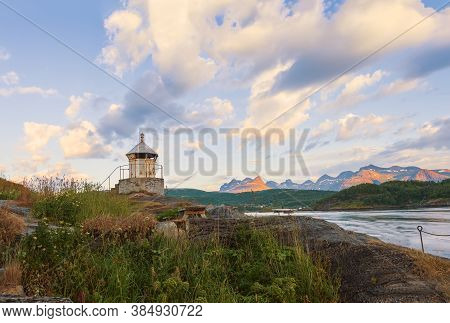 Old Lighthouse On The Shore Of The Saltstraumen Straitat Sunset. Bodo Municipality Nordland County.