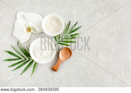 Spa Treatment Concept. Natural Organic Spa Cosmetics Products, Sea Salt, And Tropic Palm Leaves On G